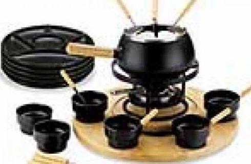 Cucinare a tavola. Fonduta, raclette e pietra ollare