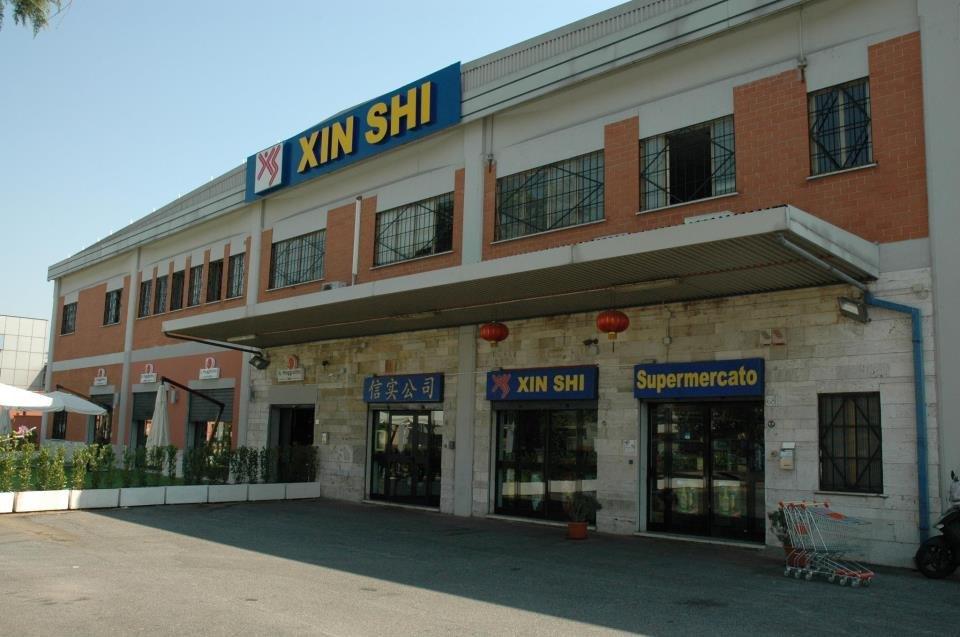 Xin Shi