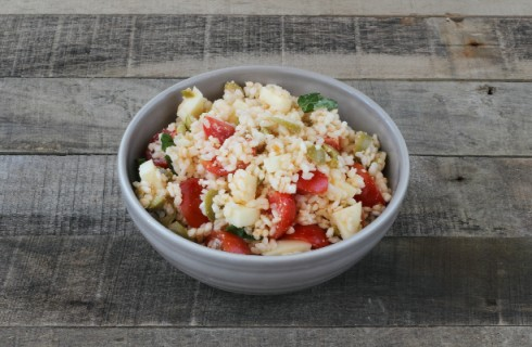 Il condimento dei peperoni ripieni di riso