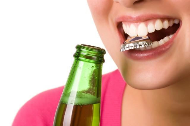 aprire coi denti