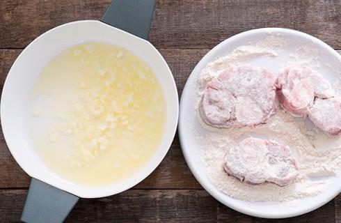 la preparazione dell'ossobuco alla milanese