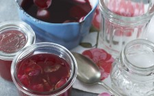 Rose jam in a preserving jar and in a saucepan