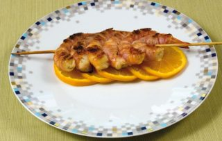 Gamberi e pancetta in salsa d'arancia